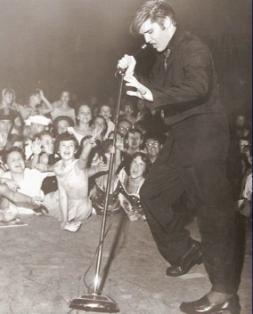 Elvis Presley on stage in 1956